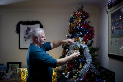 Jason decorating his Christmas tree