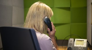 A volunteer on the phone listening to a caller