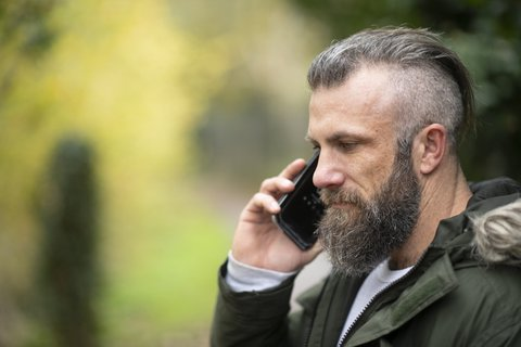 Man-phones-outdoors