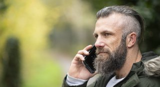 Man-phones-positive