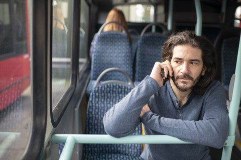 man-phone-bus