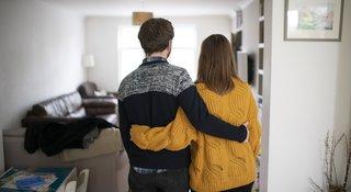couple-hug-home