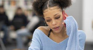 teen-listens-phone