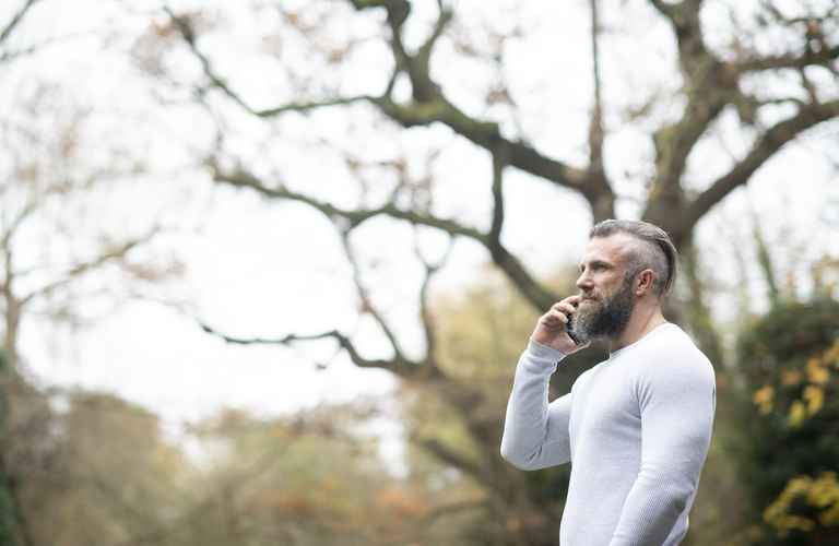 man-phone-outdoors-high-res.jpg