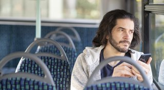 Man-phone-bus-highres