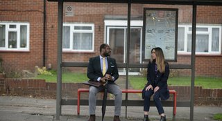 Man and woman at bus stop