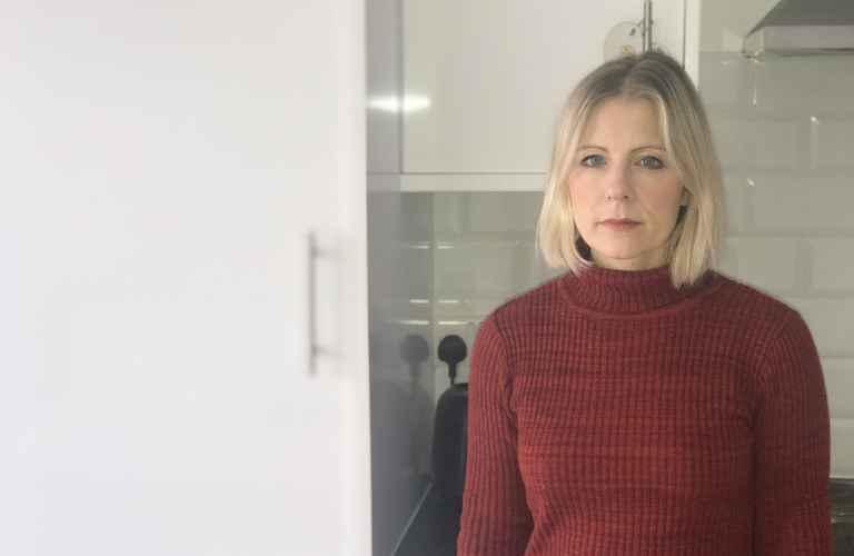 Nicola volunteer in red jumper.jpg