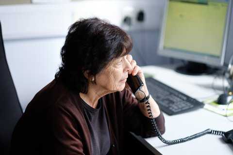 samaritans woman volunteer taking a phone call